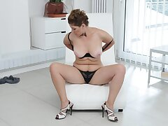 Busty mature wife Nicol in snobbish heels loves masturbating for the camera
