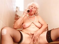 Giggling mature whore with saggy big tits Betty pets say no to wet slit