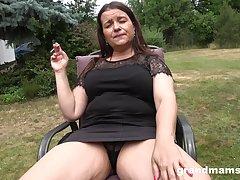 brunette mature masturbates in the nature usig a sting and big dildo