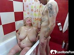 Having a nice bath while sucking his dick