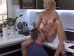 Skinny full-grown blonde mixes pile it on with a young fella in the kitchen