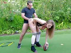Football transmitter Britney Amber sheds protective gear to enjoyment from outside