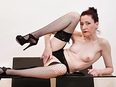 Awesome Stacey Robinson wears fishnets dimension playing with her pussy