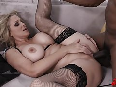 Enticing blonde housewife, Julia Ann has a thing for black guys and their rock hard cocks