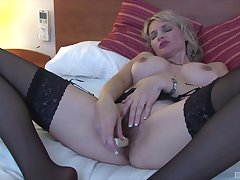 Unsurpassed matured wife in black lingerie plays with her euphoric pussy