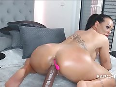 Large-Breasted tattooed cougar fucks herself with a dildo