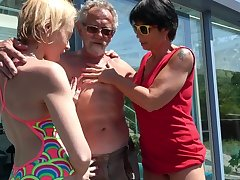 Outdoors FFM threesome between an older couple with the addition of younger Darina